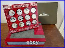 Complete set with display case. Canada Silver Lunar Lotus Coin Series with COA
